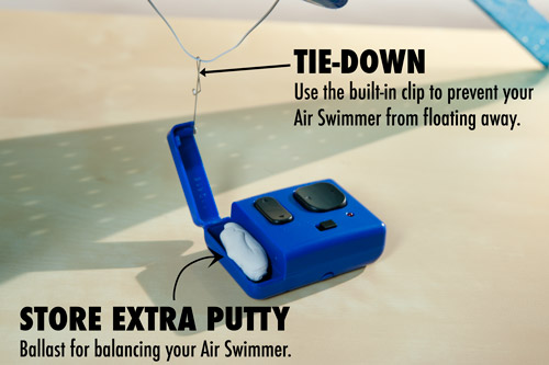 The remote control holds extra ballast and can be used to tie down the Air Swimmer and prevent it from floating away.