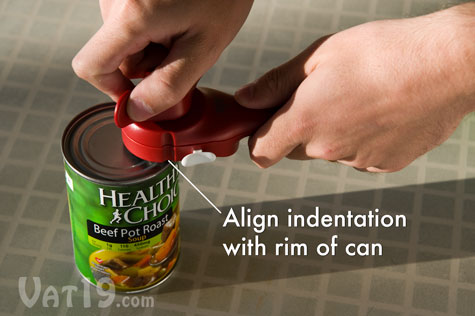 To begin opening a can with the Auto Safety Master Opener, simply align the identations with the rim of the can.