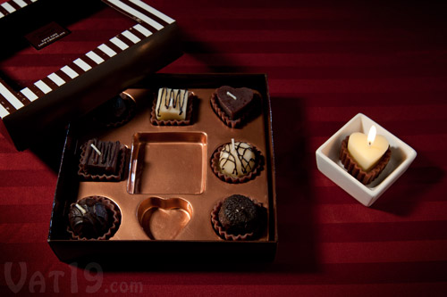 Box of Chocolates Candles on a table.