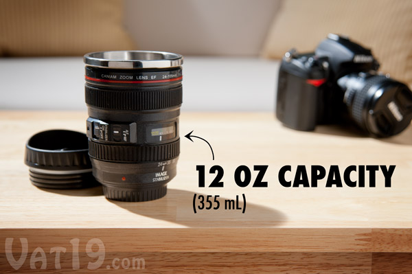Camera Lens Mug sitting on a coffee table.
