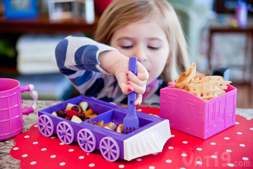 Child eating from the Chew-Chew Train dinner set.