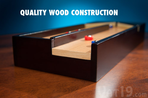 The Executive Desktop Shuffleboard Game features quality wood construction.