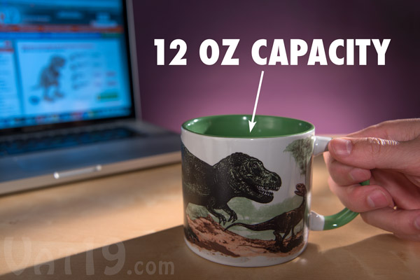 The Disappearing Dinosaur Heat Change Mug features a 14 ounce capacity.