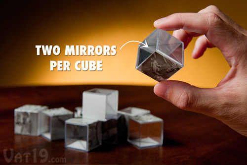 Each cube features two mirrored sides as well as sections from the five M.C. Escher images.