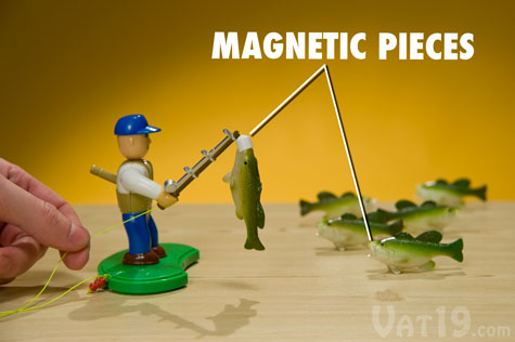 Drop the magnetic lure into the mouths of the six bass and then reel 'em in!