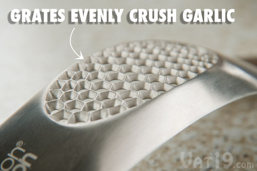 The grates on the bottom of the Garlic Rocker evenly crush your garlic.