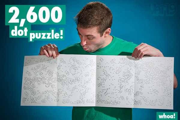 Man displaying the 4-page foldout with over 2,600 dots.