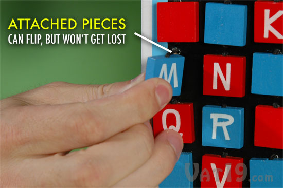 The tiles of the Hangman Travel Game are affixed with elastic, so they can be flipped, but not removed or lost.