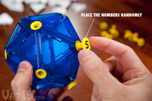 To start a game of IcoSoKu, place the number buttons randomly on the Icosahedron puzzle ball.