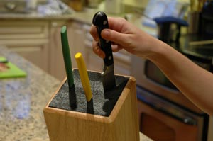 The Kapoosh Knife Block also comes in a wooden holder.