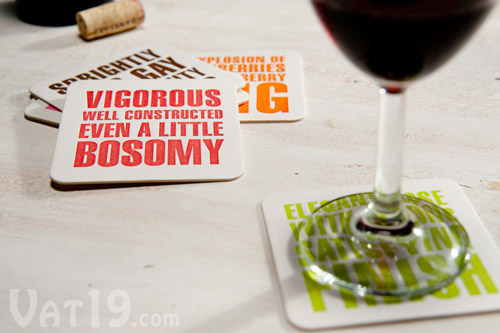 Hilarious Wine Quote Coasters on table