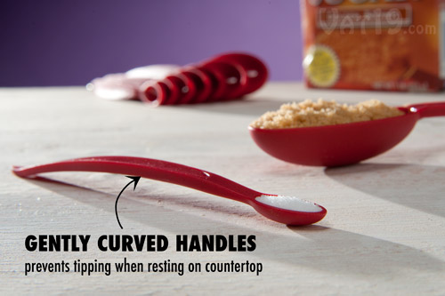 The curved handles of the Cuisipro Odd Size Measuring Scoops help them stay put when sitting on a countertop.