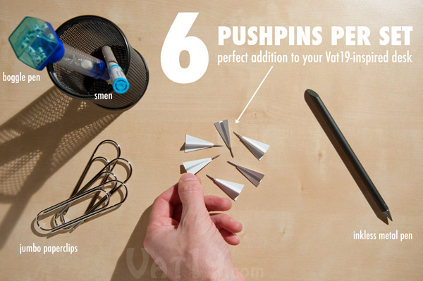 Paper Airplane Pushpins are sold in a set of six pushpins.