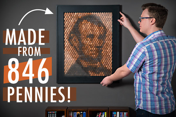 Young man hanging his Lincoln Penny Portrait in his living room.