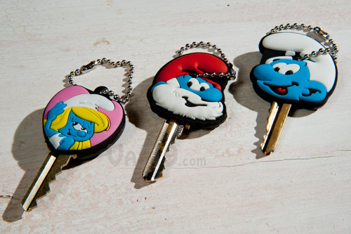 Smurf Key Caps are available in three styles: Smurfette, Papa Smurf, and Joe Smurf.