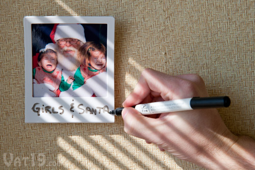 Use dry erase markers to caption your photos.