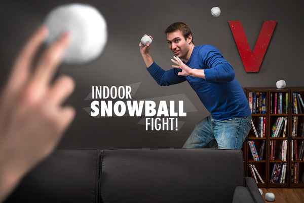 Man playing with Snowtime Snowballs indoors.
