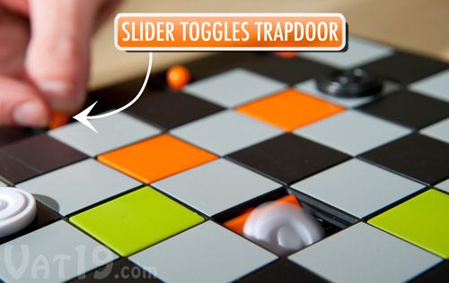 Push the trapdoor slider to activate one of eight trap doors.