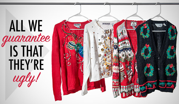 Four ugly Christmas sweaters hanging on a rack.