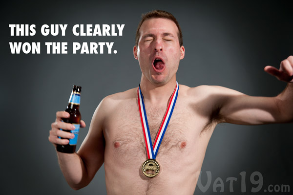 Half-naked man displaying why he won the Gold Medal Bottle Opener.