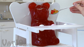 Feeding the World's Largest Gummy Bear in a high chair