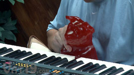 World's Largest Gummy Bear learning to play the piano.