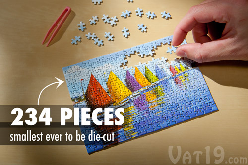 The World's Smallest Jigsaw Puzzle on a table.