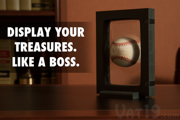 Z-Access Display Frame holding a baseball on a table.